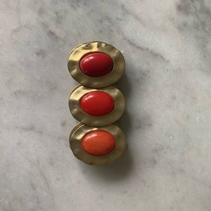 Gold bracelet with orange and red